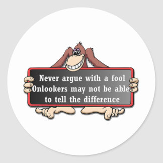 Never argue with a fool classic round sticker