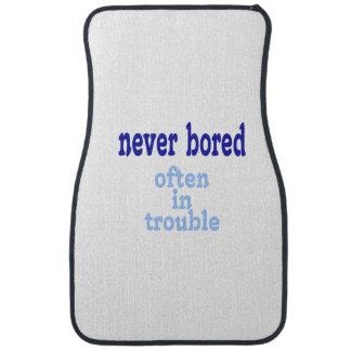 Never Bored, Often in Trouble Floor Mat