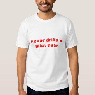Never drills a pilot hole T-Shirt