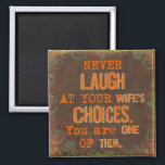 "Never Laugh At Wife's Choices Magnet<br><div class=""desc"">Like to make people smile?  This item will make a great gift for a married couple or as an anniversary or birthday joke and gag gift.</div>"