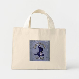 New bundle of joy with blue dino blue background bag