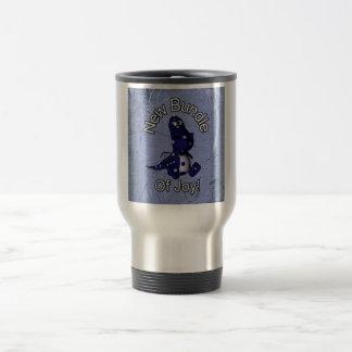 New bundle of joy with blue dino blue background travel mug