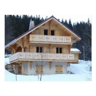 New chalet in the snow postcard