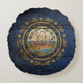 New Hampshire State Flag on Old Wood Grain Round Pillow