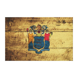 New Jersey State Flag on Old Wood Grain Canvas Print
