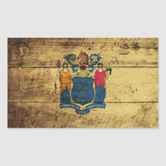 New Jersey State Flag on Old Wood Grain Rectangular Sticker