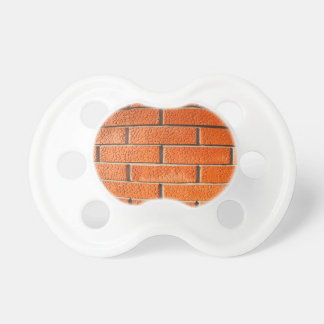 New wall of decorative red bricks close up BooginHead pacifier