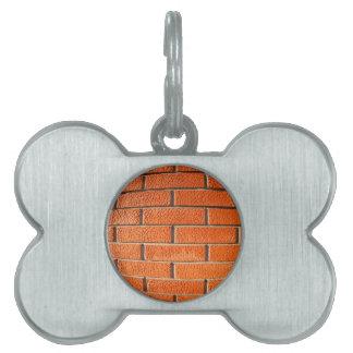 New wall of decorative red bricks close up pet name tag