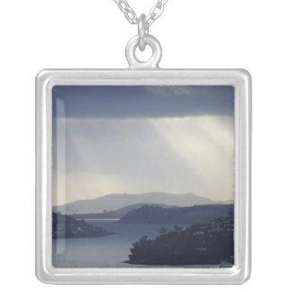 New Zealand, Otago, Dunedin, Light Shafts over Personalized Necklace
