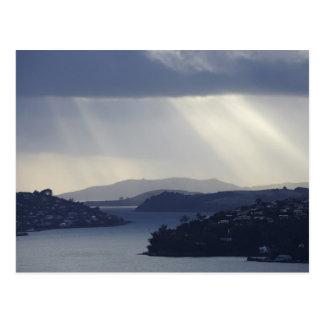 New Zealand, Otago, Dunedin, Light Shafts over Postcard