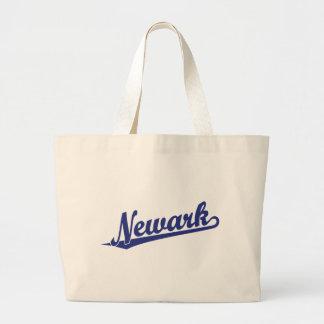 Newark script logo in blue bag