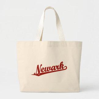 Newark script logo in red tote bag