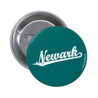 Newark script logo in white button