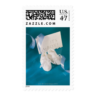 Newborn baby shoes and it's a boy announcement postage