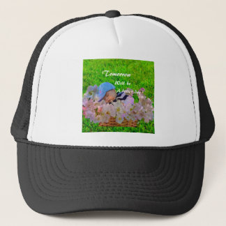 Newborn in a basket trucker hat