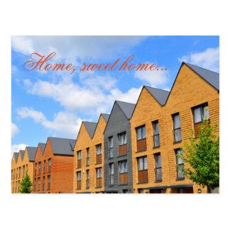 Newly built houses against blue sky postcard