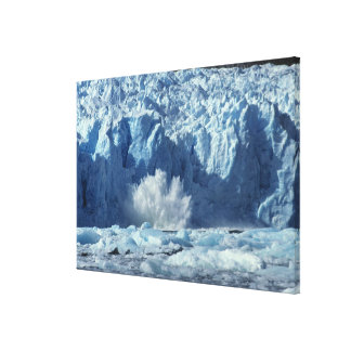 Newly-calved iceberg splashing into chilly canvas print