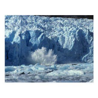 Newly-calved iceberg splashing into chilly postcard
