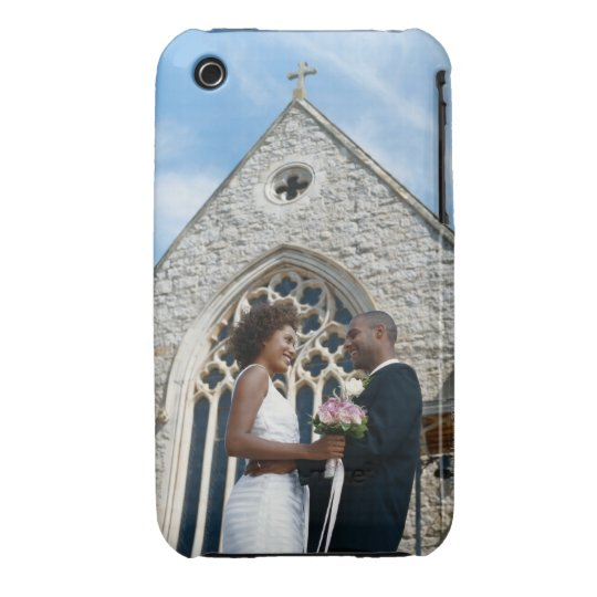 Newlywed couple standing outside church, iPhone 3 cover
