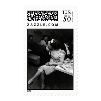 newlyweds kissing at a resturaunt postage
