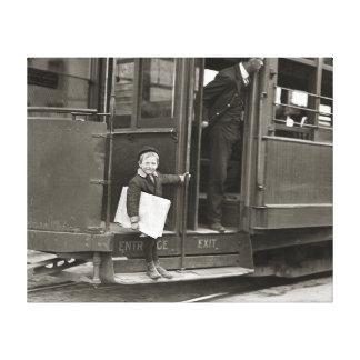 Newsboy Riding Trolley, 1910 Canvas Print