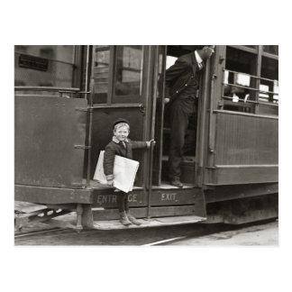 Newsboy Riding Trolley, 1910 Post Card