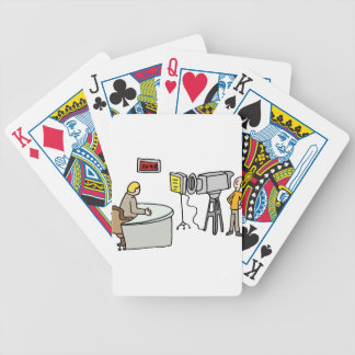 Newscaster reporting live in a studio bicycle playing cards