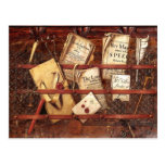 Newspapers, letters and writing implements post cards