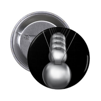 newtons cradle silver balls on black background pins