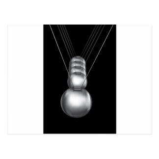 newtons cradle silver balls on black background postcard