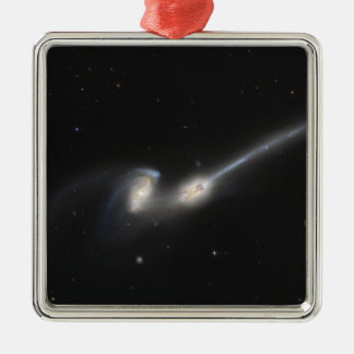 NGC 4676, also known as the Mice Galaxies Metal Ornament
