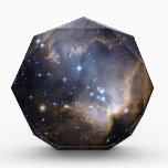 """NGC 602 bright stars NASA Award<br><div class=""""desc"""">NASA NGC 602 is a young, bright open cluster of stars located in the Small Magellanic Cloud (SMC), a satellite galaxy to the Milky Way. Radiation and shock waves from the stars have pushed away much of the lighter surrounding gas and dust that compose the nebula known as N90, and...</div>"""