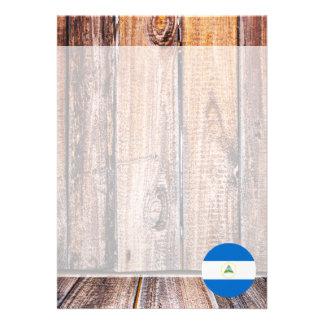 Nicaragua flag circle on wood background card