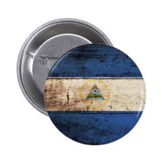 Nicaragua Flag on Old Wood Grain Pinback Button