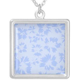 Nice light blue floral pattern. square pendant necklace