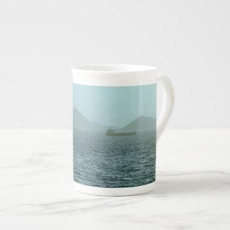 Niebla del mar de la mañana taza de té