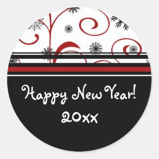 Nieve y pegatinas de la Feliz Año Nuevo de los Pegatina Redonda