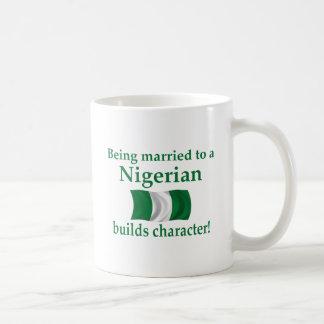 Nigerian Builds Character Mugs