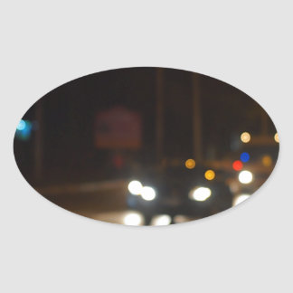 Night road in the city with abstract motion blur o oval sticker