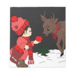 Night sky child feeding reindeer note pad