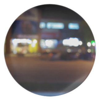 Night urban scene with blurred lights and the shop plate