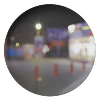 Night urban scene with blurred lights plate