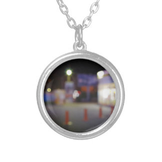 Night urban scene with blurred lights round pendant necklace