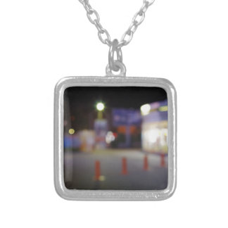 Night urban scene with blurred lights square pendant necklace