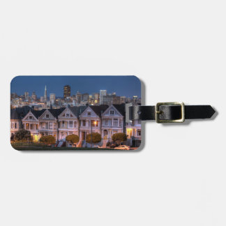 Night view of 'painted ladies'  houses luggage tag