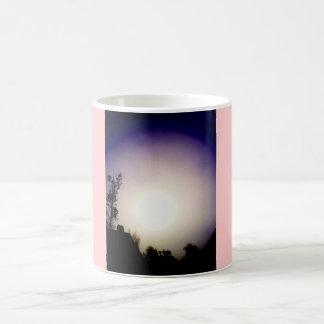 Nighttime sun coffee mug