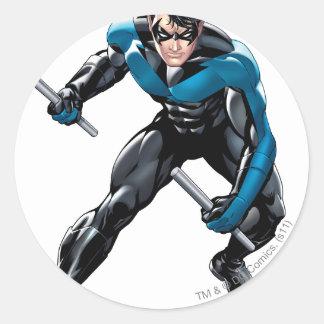 Nightwing con las armas pegatina redonda