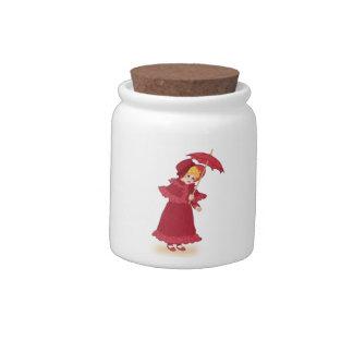 Niña con el tarro del caramelo del paraguas jarras para caramelos