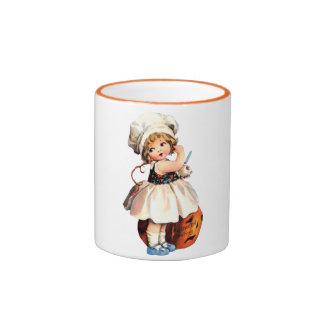 niña con la calabaza taza de dos colores