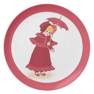 Niña con la placa del paraguas plato